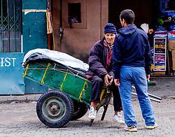 Two men chatting in a market square in the medina in Marrakech, Morocco, North Africa<br /> <br /> (c) Andrew Wilson | Edinburgh Elite media