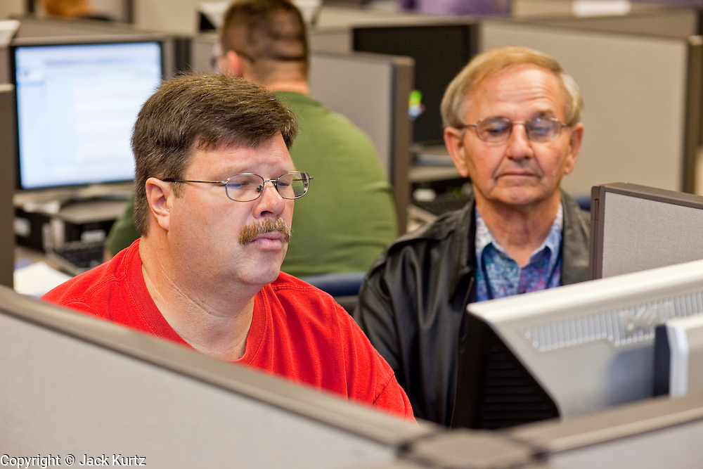 """23 February 2009 -- PHOENIX, AZ: RICHARD ABRAMOWSKI, left, and ERNEST MAJEWSKI, both from Phoenix, use the computer lab at the Maricopa Workforce Connections office in Phoenix, AZ, to look for work. Abramowski said he's been out of work since May 2008 and that he hasn't even been able to get an interview in that time, """"I'm looking for anything, but you go to an opening and there are 500 people in line for one job."""" Maricopa Workforce Connections helps people find work and transition to new work environments. According to the US Bureau of Labor Statistics, unemployment in Arizona increased from 3.9 percent in April 2008 to 6.9 percent in December 2008.    Photo By Jack Kurtz / ZUMA Press"""