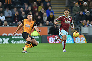Jake Livermore of Hull City kicks forward  during the Sky Bet Championship match between Hull City and Burnley at the KC Stadium, Kingston upon Hull, England on 26 December 2015. Photo by Ian Lyall.