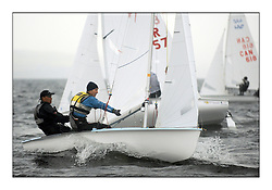470 Class European Championships Largs - Day 1.Racing in grey and variable conditions on the Clyde..RUS7, Vladimir CHAUS, Denis GRIBANOV, Krasnodar Reg.