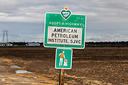 American Petroleum Institute Adopt a Highway sign near Shafter. San Joaquin Valley, California, USA