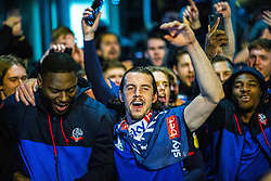 © Licensed to London News Pictures. 09/05/2021. Bolton, UK. DAPO AFOLAYAN , M J WILLIAMS and RICARDO SANTOS . The team celebrates outside the club's hotel . Bolton Wonderers supporters celebrate outside the team hotel at the University of Bolton stadium after BWFC won promotion to League One following the team's 1-4 victory over Crawley Town . Photo credit: Joel Goodman/LNP