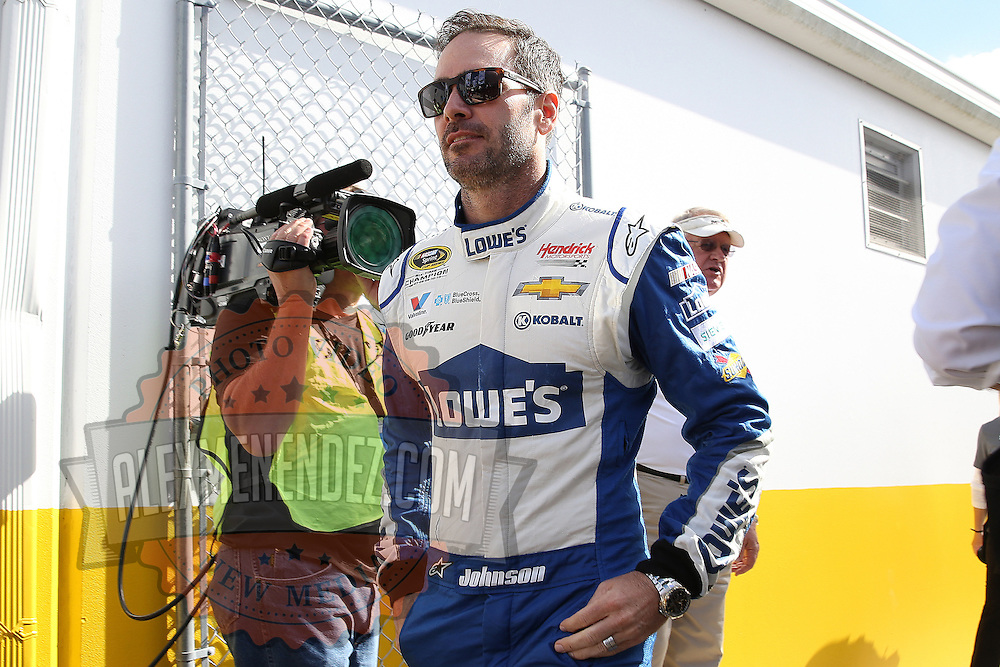 Race car driver Jimmie Johnson is seen as he makes his way to the drivers meeting prior to the 58th Annual NASCAR Daytona 500 auto race at Daytona International Speedway on Sunday, February 21, 2016 in Daytona Beach, Florida.  (Alex Menendez via AP)