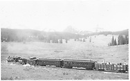 RGS #20 with short caboose #0403, coaches #320 & #306 and gondola #1754. The train is a Rocky Club excursion southbound on Lizard Head Pass with Lizard Head Peak in background.<br /> RGS  Snow, CO  5/30/1947