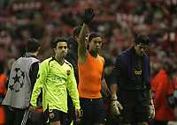Photo: Paul Thomas.<br /> Liverpool v Barcelona. UEFA Champions League. Last 16, 2nd Leg. 06/03/2007.<br /> <br /> (L-R) Dejected Barcelona players Xavi, Ronaldino and Victor Valdes leave the field.