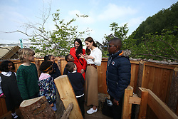 The Duchess of Cambridge speaks with children during a visit to her garden at the RHS Chelsea Flower Show at the Royal Hospital Chelsea, London.