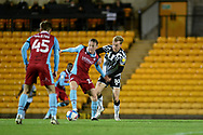 Alfie Beestin (22) of Scunthorpe United battles for possession with Tom Conlon (10) of Port Vale during the EFL Sky Bet League 2 match between Port Vale and Scunthorpe United at Vale Park, Burslem, England on 17 November 2020.