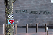 A tree wears a facemask in front of the National Gallery of Victoria during COVID-19 in Melbourne, Australia. Hotel quarantine linked to 99% of Victoria's COVID-19 cases, inquiry told. This comes amid a further 222 new cases being discovered along with 17 deaths. Melbourne continues to reel under Stage 4 restrictions with speculation that it will be extended. (Photo by Dave Hewison/Speed Media)