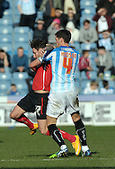 Mark Hudson of Huddersfield Town fouls Matt Derbyshire of Rotherham United during the Sky Bet Championship match at the John Smiths Stadium, Huddersfield<br /> Picture by Graham Crowther/Focus Images Ltd +44 7763 140036<br /> 07/03/2015