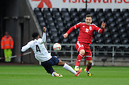 Lee Evans of Wales is tackled by England's Nat Chalobah.  UEFA 2015 European U21 championship, group one qualifier , Wales u21 v England u21 at the Liberty Stadium in Swansea, South Wales on Monday 19th May 2014. <br /> pic by Andrew Orchard, Andrew Orchard sports photography.