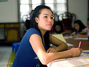 English lesson at a shelter for victims of trafficking and sexual exploitation in Vientiane, Lao PDR. In addition to providing holistic care and recovery for those rescued, AFESIP (Agir pour les Femmes en Situation Precaire / Acting for Women in Distressing Situations) offers social enterprise-based vocational training to support sustainable community reintegration.