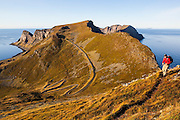 Parmenter Welty hikes a trail on the crest of Vaeroy Island, Lofoten Islands, Norway.