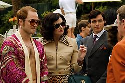 Taron Egerton plays Elton John, Richard Madden plays John Reid and Bryce Dallas Howard plays Sheila in Rocketman from Paramount Pictures.
