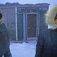 BAFFIN ISLAND, Nunavut, Canada. Young Inuit guides, Ben Illuaq (L) & Romeo Palluq by hunting cabin north of Clyde River.