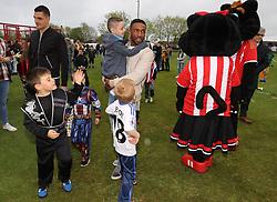 Sunderland footballers Jermain Defoe and Vito Mannone (left) with terminally ill football mascot Bradley Lowery, as he celebrates his sixth birthday at Blackhall Cricket Club near Durham.
