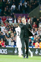 Football - 2016 / 2017 Premier League - Swansea City vs. Everton<br /> <br /> Swansea City manager Paul Clement applauds the fans after Swansea win, his team celebrate in background , at Liberty Stadium.<br /> <br /> COLORSPORT/WINSTON BYNORTH