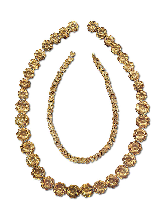 Mycenaean gold necklace from the Mycenaean cemetery of Midea tholos tomb , Dendra, Greece. National Archaeological Museum Athens. White Background.<br /> <br /> Inside mycenaean necklace has gold ivy leaf beads, Cat No 7354. The outer mycenaean necklace has rosette shaped gold beads, Cat No 7342. 15th-14th century BC. .<br /> <br /> If you prefer to buy from our ALAMY PHOTO LIBRARY  Collection visit : https://www.alamy.com/portfolio/paul-williams-funkystock/mycenaean-art-artefacts.html . Type -   Athens    - into the LOWER SEARCH WITHIN GALLERY box. Refine search by adding background colour, place, museum etc<br /> <br /> Visit our MYCENAEN ART PHOTO COLLECTIONS for more photos to download  as wall art prints https://funkystock.photoshelter.com/gallery-collection/Pictures-Images-of-Ancient-Mycenaean-Art-Artefacts-Archaeology-Sites/C0000xRC5WLQcbhQ