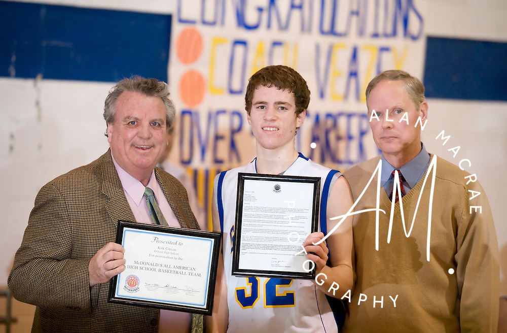 McDonald's District Manager Larry Johnston presents Gilford's Kirk Crecco with a letter and certificate marking Crecco's nomiation to the McDonald's All Star basketball team.  Looking on is Gilford High coach Chip Veazey.  (Alan MacRae/for the Citizen)