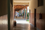 Dr Peter O'Reilly, sitting in one for the busy corridors of St Walburg's Hospital, Nyangao. Lindi Region, Tanzania.
