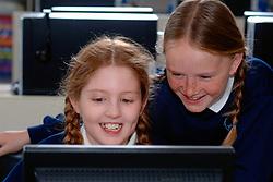 Primary schoolchildren using computers; Yorkshire UK