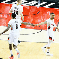 25 April 2016: Portland Trail Blazers guard Damian Lillard (0) is congratulated by Portland Trail Blazers forward Al-Farouq Aminu (8) next to Portland Trail Blazers center Mason Plumlee (24) during the Portland Trail Blazers 98-84 victory over the Los Angeles Clippers, during Game Four of the Western Conference Quarterfinals of the NBA Playoffs at the Moda Center, Portland, Oregon, USA.