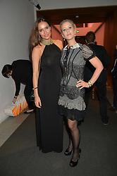 Left to right, SASHA VOLKOVA and ELISABETH ESTEVE at She Inspires Art in aid of Women for Women International's work, held at Bonham's, 101 New Bond Street, London on 16th September 2015.