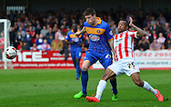 Durrell Berry tackles Bobby Grant during the Sky Bet League 2 match between Cheltenham Town and Shrewsbury Town at Whaddon Road, Cheltenham, England on 25 April 2015. Photo by Alan Franklin.