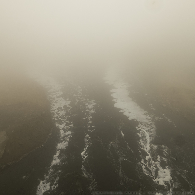 Air and water pollution in Delhi on a winter day. Shahadra drain.