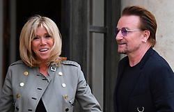 U2 lead singer and co-founder of the organisation ONE Bono stands alongside French First Lady Brigitte Macron at the Elysee Palace in Paris, France, on July 24, 2017. Bono will be meeting the French president in a bid to champion his organisation One which battles against extreme poverty and illness, particularly in Africa. Photo by Christian Liewig/ABACAPRESS.COM