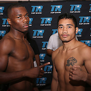 Toka Kahn Clary (L) and John Gemino are seen during weigh ins for the Top Rank boxing event at Osceola Heritage Park in Kissimmee, Florida on September 21, 2016.