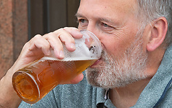 ©Licensed to London News Pictures 15/07/2020     <br /> Petts Wood, UK. This man enjoying his 20 percent full VAT beer outside the Wetherspoon pub in Petts Wood, South East London. Chancellor Rishi Sunak has cut VAT on food and non alcoholic drinks eaten at restaurants,bars,pubs and clubs but booze is excluded. Photo credit: Grant Falvey/LNP