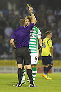 Bryon Webster, Captain of Yeovil Town receives a yellow card during the Capital One Cup match, 2nd round, Yeovil Town v Birmingham City at Huish Park in Yeovil on Tuesday 27th August 2013. pic by Sophie Elbourn, Andrew Orchard sports photography,