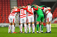 Doncaster players huddle together before the EFL Sky Bet League 1 match between Doncaster Rovers and Scunthorpe United at the Keepmoat Stadium, Doncaster, England on 15 December 2018.