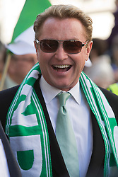 © Licensed to London News Pictures. 16/03/2014. London, England. Pictured: Irish-American Dance-Star Michael Flatley. St Patrick's Day Parade in Central London. Photo credit: Bettina Strenske/LNP