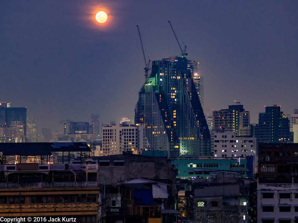 23 MARCH 2016 - BANGKOK, THAILAND: The full moon over the Talat Noi section of Bangkok's Chinatown.      PHOTO BY JACK KURTZ