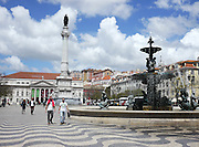Fountain in Rossio Square, Lisbon, Portugal. The Column of Pedro IV is in the middle of the square.