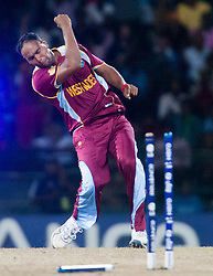 © Licensed to London News Pictures. 05/10/2012. West Indian Samuel Badree celebrates after getting the important wicket of Shane Watson during the World T20 Cricket Mens Semi Final match between Australia Vs West Indies at the R Premadasa International Cricket Stadium, Colombo. Photo credit : Asanka Brendon Ratnayake/LNP