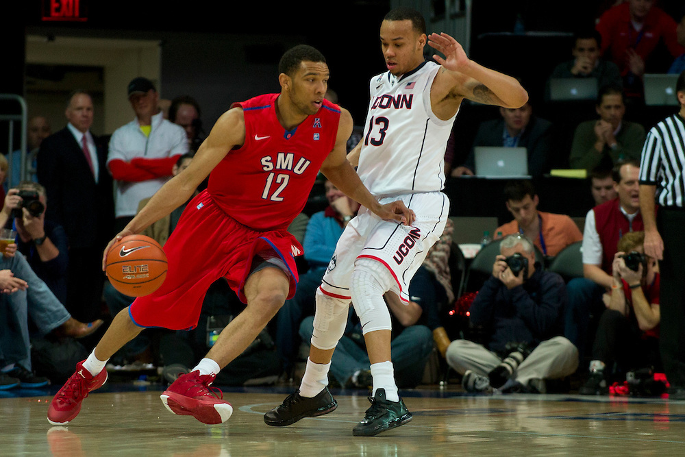 DALLAS, TX - JANUARY 4: Nick Russell #12 of the SMU Mustangs drives to the basket against Shabazz Napier #13 of the Connecticut Huskies on January 4, 2014 at Moody Coliseum in Dallas, Texas.  (Photo by Cooper Neill) *** Local Caption *** Nick Russell; Shabazz Napier