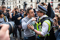 © Licensed to London News Pictures. 31/08/2019. London, UK. A far-right pro-Brexit activist clashes with a police officer and a protester as thousands gather outside Downing Street to protest against the suspension of Parliament. The Queen has approved Prime Minister Boris Johnson's request to prorogue Parliament shortly after MPs return to work in September, a few weeks before the Brexit deadline of 31 October. Photo credit: Rob Pinney/LNP