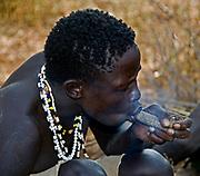 Hadzabe hunter smoking marihuana. Lake Eyasi, northern Tanzania.