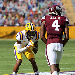 Sep 26, 2020; Baton Rouge, Louisiana, USA; LSU Tigers cornerback Eli Ricks (1) defends Mississippi State Bulldogs wide receiver Malik Heath (4) during the first half at Tiger Stadium. Mandatory Credit: Derick E. Hingle-USA TODAY Sports