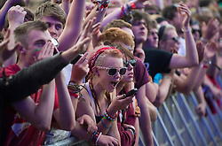 © London News Pictures. 25/08/2012. Reading, UK. Revelers watching Enter Shikari perform on the main stage on day two of Reading Festival 2012 in Reading, Berkshire, UK on August 25, 2012. The three day event which attracts over 80,000 music fans headlines The Cure, Kasabian and The Foo Fighters Photo credit : Ben Cawthra/LNP