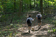 Vernon, New Jersey - Two hikers and their dog walk through the woods on Appalachian Trail at the base of  Wawayanda Mountain on Sept. 22, 2012.
