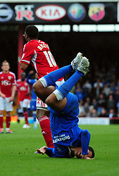 Birmingham City's Curtis Davies end up in a heap after a challenge from Bristol City's Nicky Maynard - Photo mandatory by-line: Joseph Meredith/JMPUK - 23/10/2011 - SPORT - FOOTBALL - Championship - Bristol City v Birmingham City  - Ashton Gate Stadium - Bristol - England