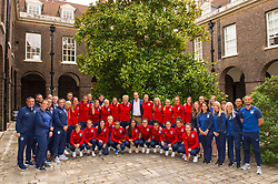 The Duke of Cambridge and members of the England Women football team pose for a group photograph during a reception for the England Women football team at Kensington Palace in London..