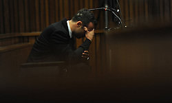 BY COURT ORDER, THIS IMAGE IS FREE TO USE.<br /> 61178307<br /> The accused Oscar Pistorius in the Pretoria High Court on March 6, 2014, in Pretoria, South Africa. Pistorius stands accused of the murder of his girlfriend, Reeva Steenkamp, on February 14, 2014. This is Pistorius official trial, the result of which will determine the paralympian athlete s fate,Thursday, 6th March 2014. Picture by  imago / i-Images<br /> UK ONLY