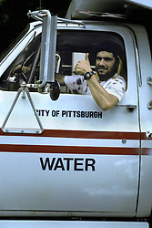 Americana City of Pittsburgh water department truck driver workergives thumbs up sign Stock photo