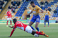 CJ Hamilton of Mansfield Town (22) fouls Mark Marshall of Charlton Athletic (7) during the The FA Cup match between Mansfield Town and Charlton Athletic at the One Call Stadium, Mansfield, England on 11 November 2018.