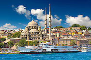The Yeni Camii, The New Mosque or Mosque of the Valide Sultan ordered by Safiye Sultan in 1597 with a ferry on  the banks of the Golden Horn, Istanbul Turkey. .<br /> <br /> If you prefer to buy from our ALAMY PHOTO LIBRARY  Collection visit : https://www.alamy.com/portfolio/paul-williams-funkystock/istanbul.html<br /> <br /> Visit our TURKEY PHOTO COLLECTIONS for more photos to download or buy as wall art prints https://funkystock.photoshelter.com/gallery-collection/3f-Pictures-of-Turkey-Turkey-Photos-Images-Fotos/C0000U.hJWkZxAbg