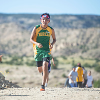 Kyle Thomas, a sophomore at Thoreau competes in a 3.1 mile course in Tohatchi at the Nashdoitsoh Meet Friday afternoon.